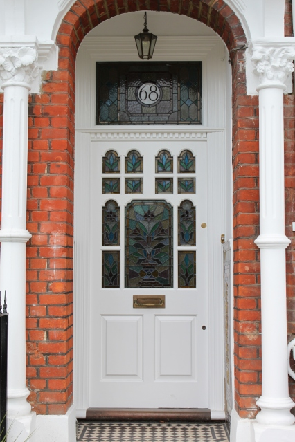 A late Victorian front door with floral leaded light