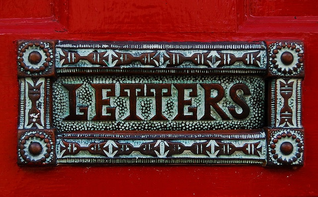 A lovely old letterplate with plenty of verdigris